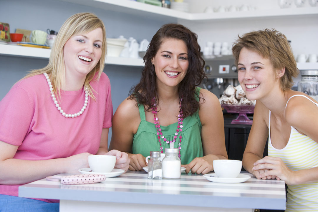 young-women-enjoy-tea-in-a-cafe-VID